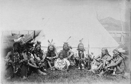 A Group of Dancers Seated in Front of a Tent.