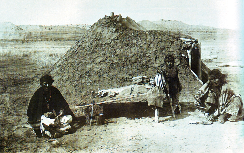 A Navajo Silversmith Hammers Silver Outside His Earth Lodge.
