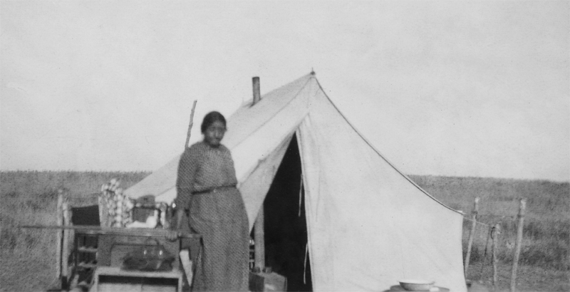 An Indian Women in Front of a Tent.