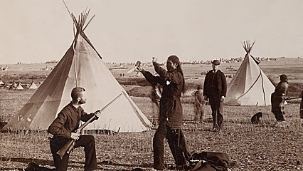 Mock Combat Between CH Cressey and an Unidentified Sioux Indian 1890.