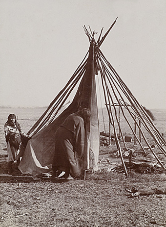 A Cheyenne Woman and Child Raising a Tipi.