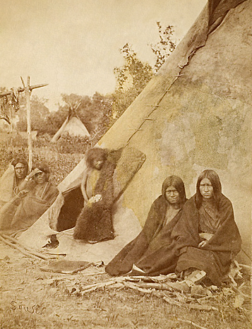 A Comanche Family in Front of a Buffalo Skin Tipi.