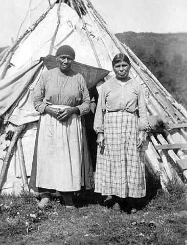 Mrs Tamarack and Mrs Mary Spruce (Wives of Joe Spruce) in Front of a Wigwam.