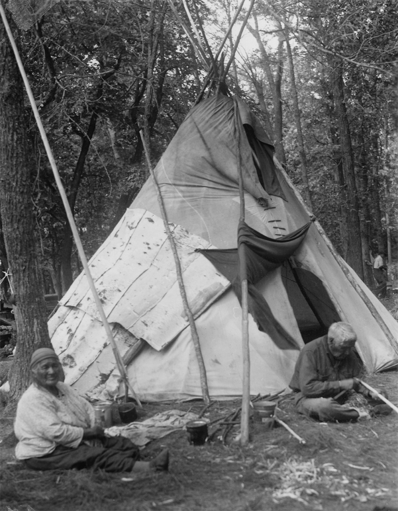 Rabit and his Wife Siting in Front of Their Teepee.
